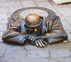 "Man at work - ""Čumil"" - one of the favourite statues in Old Town of Bratislava, Slovakia"