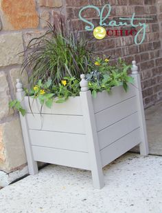 $15 Outdoor Planter Box  Hey guys!  I am loving my latest project!! I have been wanting planter boxes for the front door for some time now.  I knew just who to ask for help!  Ana and I came up with these great planter boxes!  The best part??  They only cost $15 a pop to build!  Woohoo!!