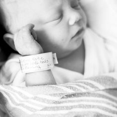 photo of the hospital bracelet and baby close up  <3