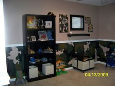 Army Room, painted camouflage on the bottom half of the wall.