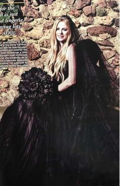 Canadian singer-songwriter Avril Lavigne wore a black wedding dress to say her vows to rocker Chad Kroger, frontman of the band Nickelback, on July 1, 2013.