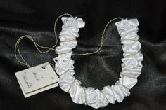 Ivory Satin Horseshoe with roses & a chain wrist strap