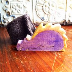 Sweet wooden dragon toy in a cozy knitted cave. Waldorf style toy.