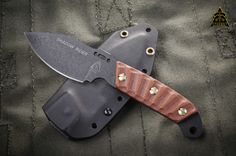 """O/A Length: 7 3/4"""" Blade Length: 3 1/4"""" Thickness: 1/8"""" Steel: 1095 High carbon Steel RC 56-58 Handle: ( NEW Style Rocky Moutain Tread) TAN CANVAS MICARTA Blade Color: Black Traction Coating MANUFACTURED: TOPS KNIVES (ROCKY MOUNTAINS USA)"""