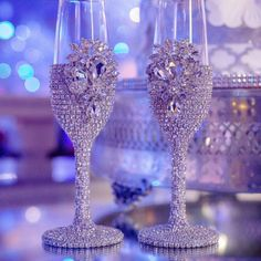 """Our best-selling signature """"Audrey"""" Czech-Crystal encrusted champagne toasting flutes, as seen in Ebony Magazine. Available with matching cake knife and server set. Bride And Groom Glasses, Wedding Wine Glasses, Diy Wine Glasses, Decorated Wine Glasses, Wedding Champagne Flutes, Wedding Bottles, Painted Wine Glasses, Diy Bottle, Bottle Crafts"""