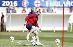 Rooney pictured on the ball during the England training session in Chantilly as excitement built ahead of Euro 2016's start