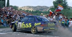 Carlos Sainz using his 555 Subaru Impreza to get in touch with the fans during the 1995 Rallye Catalunya. Subaru Wrc, Subaru Rally, Rally Car, Subaru Impreza, Wrx Sti, Colin Mcrae, Japanese Monster, Jdm Cars, Vintage Racing