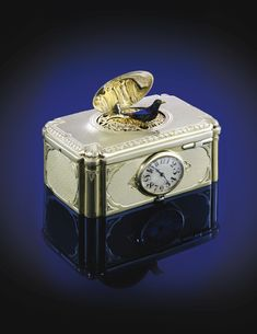 SWISS, A SILVER GILT AND ENAMEL SINGING BIRD BOX CIRCA 1930