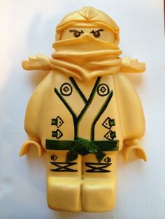 Gold ninja from Ninjago. Made with fondant and hand painted.