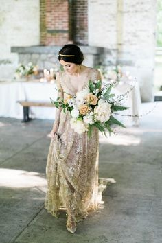 Start your gold wedding plans with a lace gown with touches of gold!