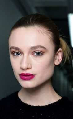 Novis offered up a real-life way to wear color on your eyes and cheeks: Makeup artist Uzo painted shocking shades of magenta and red on the lips, and gave the lids a soft, shimmery, taupe-y smoke.