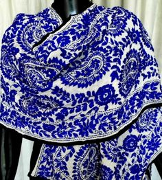 This stunning georgette phulkari dupatta/stole is embroidered with wool in the karachi jaal work pattern, with little flat sequins stitched in at intervals. A great accessory for any look, any dress. Length: 98 in, Width: 18 in. - See more at: http://www.giftpiper.com/White-BlueGeorgettePhulkariDupatta-Stole-id-660356.html#sthash.J64g9RIL.dpuf