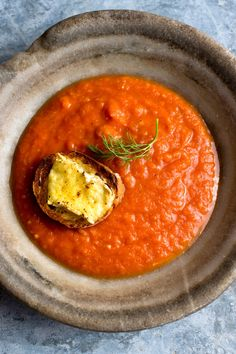 NYT Cooking: The childhood pleasure of tomato soup with a side of grilled cheese had been enshrined in my mind since I'd last had it, decades ago. A tart, bright tomato soup and a crispy sandwich with an oozing interior: no wonder they are an iconic match. This recipe, spiked with fennel and Pernod, is livelier and more sophisticated than your usual tomato soup. It has a more%2...