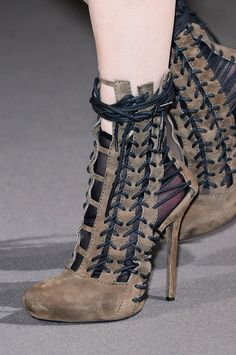 Haider Ackermann --and these are so odd and weird...So happy they aren't black leather though...