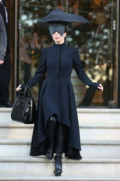 Lady Gaga wearing an Alexander McQueen Pre A/W 2013 black coat dress, leather thigh boots and S/S 2013 Heroine bag in London