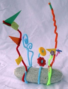 "Alexander Calder Stabile Sculpture Using only pipe cleaners, a rock (or other base like a chunk of Styrofoam), build a ""stabile"". Add whatever you have on hand. We had buttons and paper scraps and beads to add to ours. Any kind of wire will work, including the new plastic-coated wires in craft stores (in colors). This idea is found in ""Great American Artists for Kids"" by Kohl and Solga."
