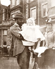 King George V and Queen Mary with their son David, later Edward VIII.  Looks for once like a normal family!