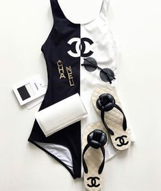 Chanel delivers another must-have piece for spring a one-piece, modestly cut black and white swimsuit detailed with the label's famed double C logos. Black And White One Piece, Black And White Swimsuit, Chanel Outfit, Chanel Fashion, Fashion Beauty, Fashion Art, Jogging Style, Mode Du Bikini, Dior