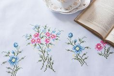 Hand cross stitch embroidered white table topper