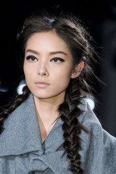 Get the look : Braided pigtails. Tips here on how to keep this look fresh and modern!