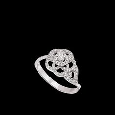 Camélia Ring in 18K white gold and diamonds. - CHANEL