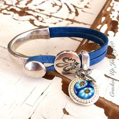 Broken China Jewelry. Cool Leather Bracelet by CrackedUpJewelry. Blue leather bracelet with Murano glass broken china charm!