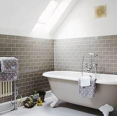 grey subway tile & painted iron tub.  could just pull this off.
