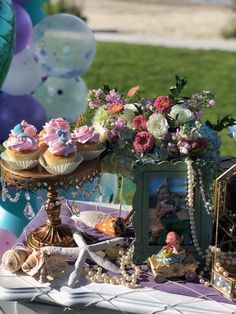 Mermaid Cake Table Detail from a Mermaid Birthday Party on Kara's Party Ideas | KarasPartyIdeas.com (17) Mermaid Party Decorations, Mermaid Parties, Flower Decorations, Girl Birthday Cupcakes, 2nd Birthday Parties, Themed Parties, Gold Vase Centerpieces, Mermaid Tail Cake, White Dessert Tables