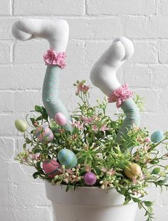 Here's a cute bunny leg arrangement created by RAZ using their cute polka dot bunny legs. You could create this arrangement with any sort of pot suitable for Easter, fill the bottom with some Styrofoam and just pop the bunny legs in. They come flexible wire stick so you can shape them any way you …