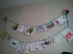 Kids Art Display- $2.99 tulle from Michael's, clothespins, 2 windmills and thumbtacs. So easy! Eventually I'll paint the clothes rainbow colors, but the art just had to get up! ; )