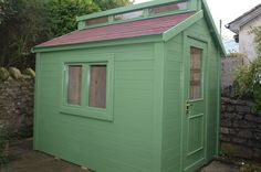Contemporary shed finished with sadolin superdec in wild grape