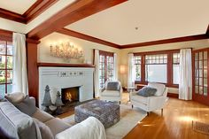 """We have """"hot cocoa"""" colored walls and medium tone wood trim, but I'd like to lighten it up with a cream color like this."""