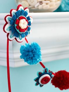 """Daisy Felt Garland: Fashion a swag with flower power by stringing button-capped felt flowers on a mantel."""