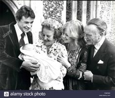 Download this stock image: 1972 - Hayley Mills's Month Old Love Baby Jason Is Christened Actress Hayley Mill's month old Love Baby Jason was christened at the Parish Church, Denham, Bucks. Where she was herself christened 30 years ago. Hayley Mills is married to film producer Roy Boulting, but they are parted. Jason's father is actor Leigh Lawson, they have no plans to marry. Photo Shows:- Seen after the Christening at the Paris Church Denham L-R Leigh Lawson, father of the baby, ...