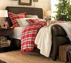 rich leather bed & plaid bedding...perfect for winter.