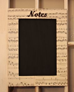 Frame covered with vintage sheet music made into chalk-memo-board