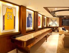 Man Cave Ideas and a Guide to a Successful Design - Man Cave Home Bar - Man Caves Basements Man Cave Diy, Man Cave Home Bar, Sports Man Cave, Contemporary Family Rooms, Shuffleboard Table, Framed Jersey, Ultimate Man Cave, Man Cave Basement, Family Room Design