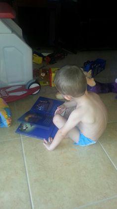 Alex reading to Mimi
