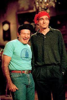 """Robin Williams shares a laugh with singer James Taylor on the set of """"Saturday Night Live"""" at NBC Studios in New York, Jan. 21, 1988.  (AP Photo/Richard Drew)"""