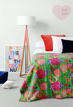 Remade vintage indian quilts. Also, I love the wall art on the floor