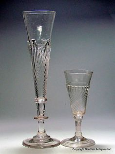 An earl flammiform ale glass with a similar small example to provide scale http://www.scottishantiquesinc.co.uk/georgian-glass/ale