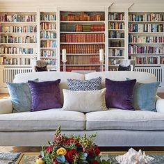 """""""It took quite a lot of work to make the original bookcase symmetrical, but it was worth preserving as it is a wonderful feature,"""" says owner Jasmine of her family's well-stocked library. The cushions in rich jewel-tones are from @inkyvelvetltd while the Snowdrop Sofa from @sofadotcom is a similar style to this one. Photograph by Catherine Gratwicke. #interiors #livingroom"""