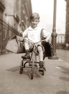 a rare image of After food sale, showing a boy on a tricycle.