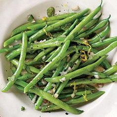 Steamed Green Beans with Lemon-Mint Dressing | MyRecipes.com  Instead of mint, tarragon or basil would be equally delicious. If desired, top with fresh lemon rind for a little extra zing.
