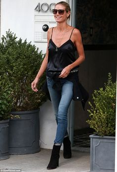 Casual and cool: Heidi Klum was spotted exiting her residence in New York City on Wednesda...