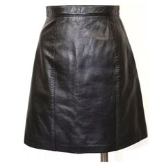 """St. John Collection Soft Black Leather Skirt 2 ‼️ PRICE FIRM UNLESS BUNDLED WITH OTHER ITEMS FROM MY CLOSET ‼️   Size 2  Retail $765  Gorgeous skirt by St. John Collection. Butter soft black leather, fully lined.  This is an amazing skirt that is a classic. 100% leather.  Lining: 65: acetate, 35% polyester.  Please check my closet for many more items including designer clothing, jewelry, scarves & more.  All measurements are taken with garment lying flat.  Waist 24""""  Hips 33""""  Length of…"""