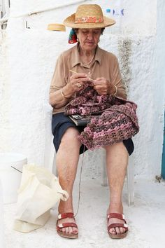 photo by mara desipris, lady crocheting at a greek island