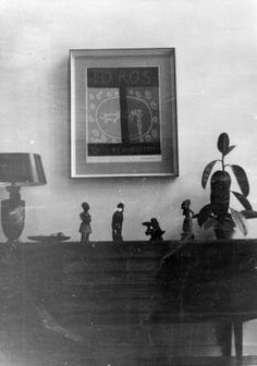 Printed black and white photograph of the dining room of Mr and Mrs H's home on a housing estate in Highgate, London. The photograph was probably taken by Mr H in about 1958. This is a copy made from original photograph for the Geffrye Museum in 1996, and is one item in the Documenting Homes collection (185/2010-1 to –60) from Mr and Mrs H.