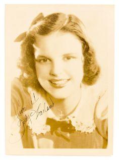 A Judy Garland signed sepia photograph, circa 1938