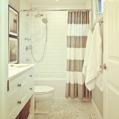 beige + white + striped bathroom... trying to decide to replace the shower with a tub and subway tiles... so pretty